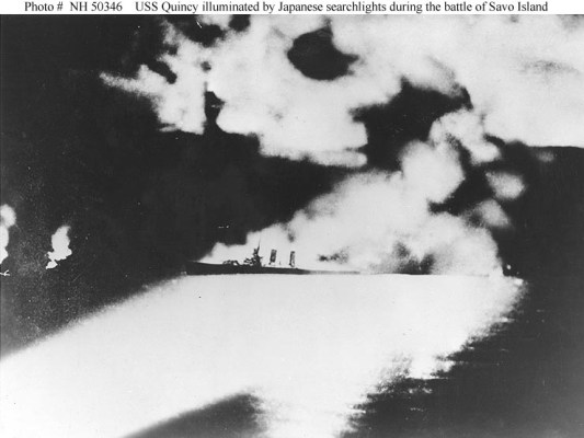 USS Quincy Illuminated by Japanese searchlights at Battle of Savo Island