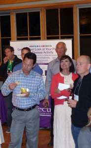 Conference attendees being welcomed to reception