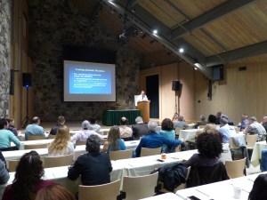 Dr. Dick Whitten of Noridian presenting reimbursement updates and trends.