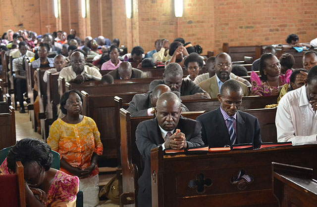 The Church reformed kneels in prayer