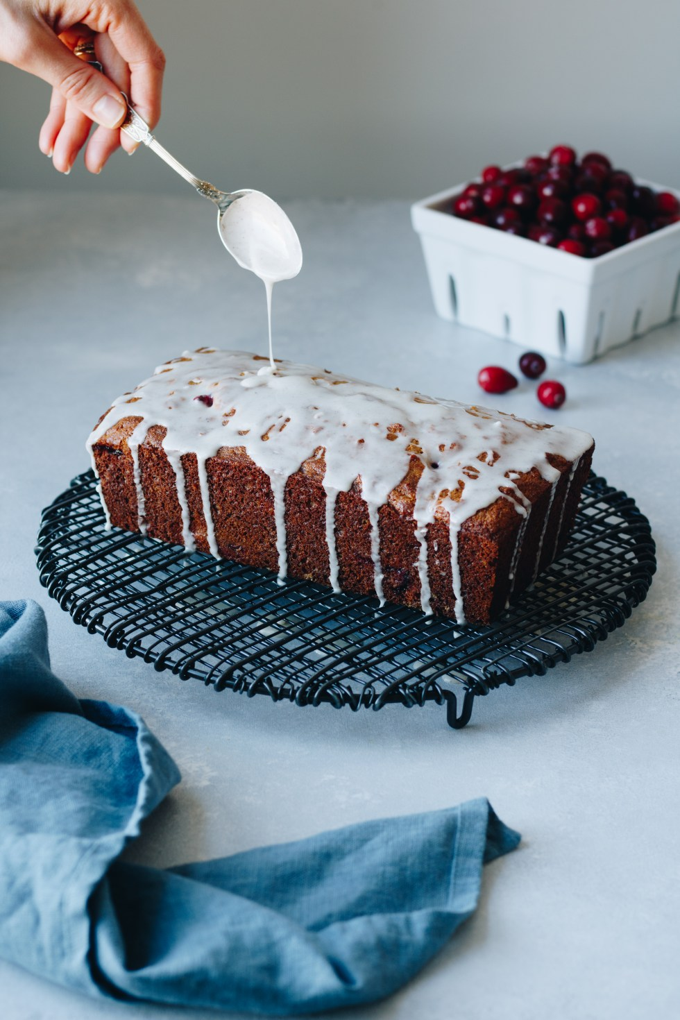 Cranberry Cardamom Spelt Loaf with Orange Vanilla Bean Glaze - warmandrosy.com
