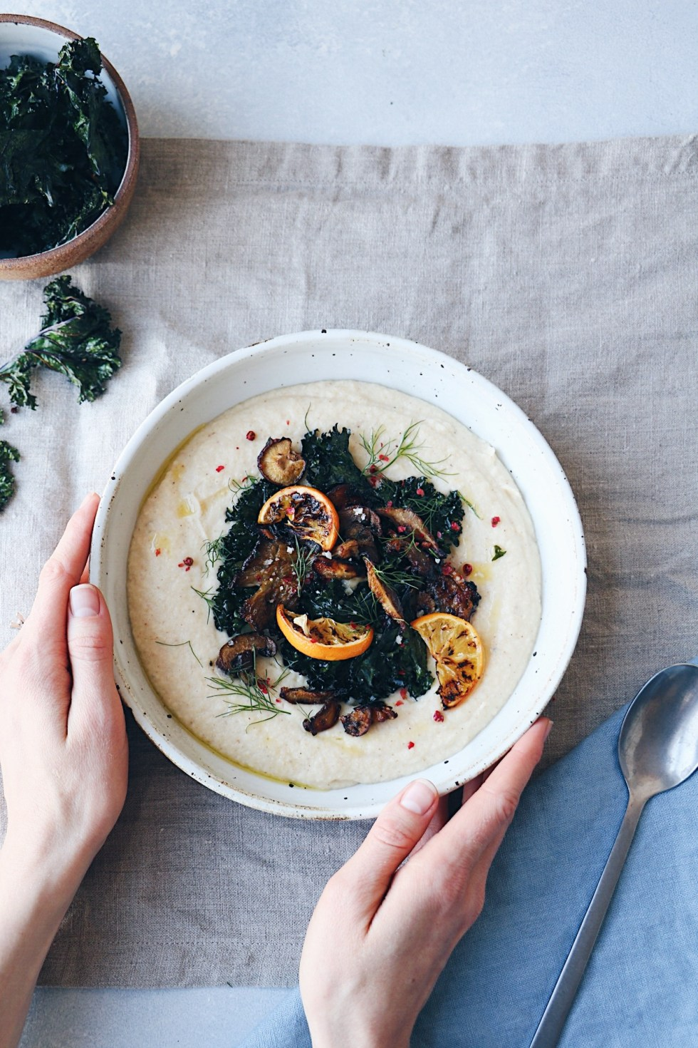 Creamy Roasted Cauliflower + Meyer Lemon Soup with Crispy Kale and Mushrooms - warmandrosy.com