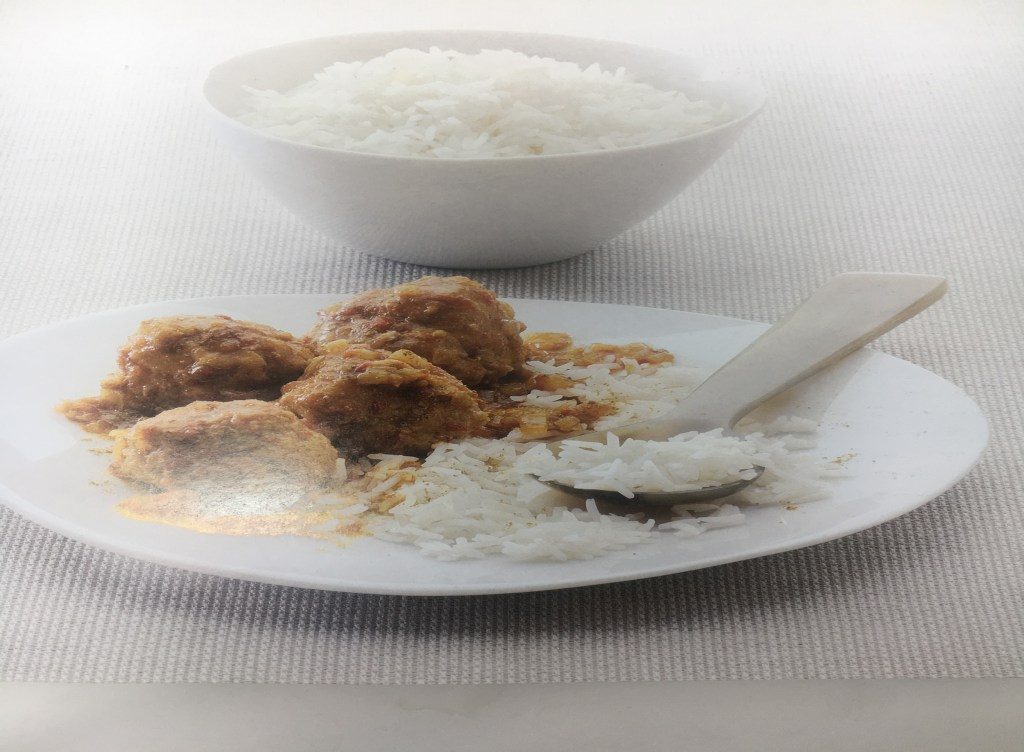 warm and tote goan pork meatballs in spicy curry