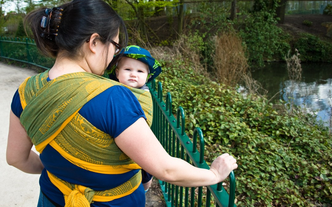 Mother wearing her baby in a wrap in Crystal Palace Park, photographed by Anna Hindocha/Warm Glow Photo.
