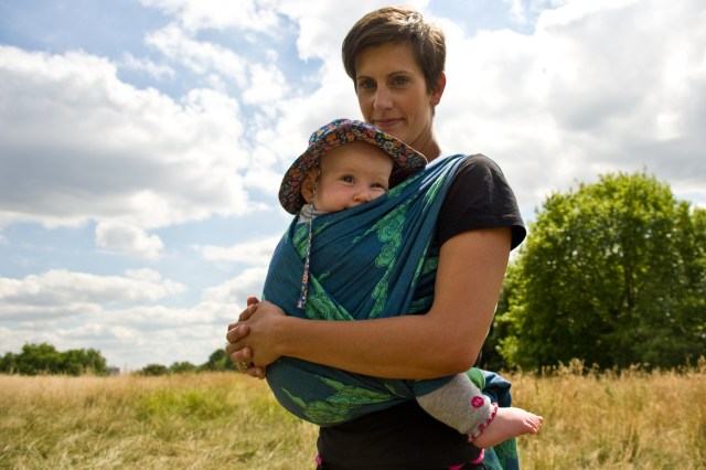 Mother wearing her child in an Oscha wrap in a park, photographed by Anna Hindocha/Warm Glow Photo