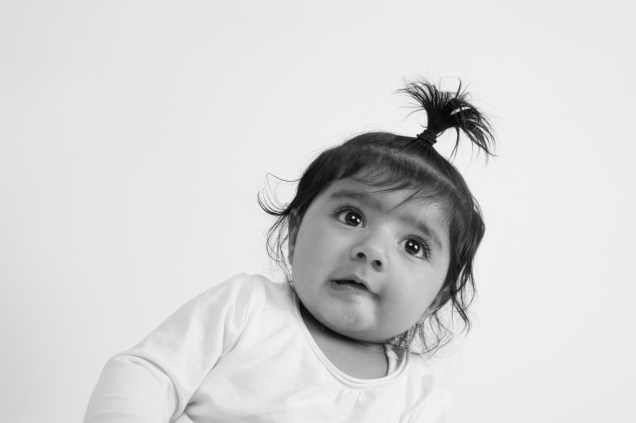 Black and white studio portrait of a baby girl by Anna Hindocha/Warm Glow Photo
