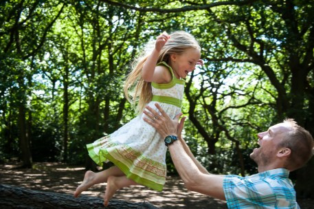 Young girl with her father in Streatham Common Woods, photographed by Anna Hindocha/Warm Glow Photo