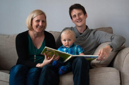 One year old boy reading with his parents, photographed by Anna Hindocha/Warm Glow Photo
