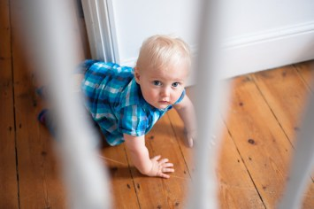 One year old boy playing, photographed by Anna Hindocha/Warm Glow Photo