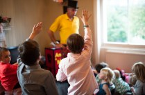 Children watching magic show, at The Rosendale, Dulwich. Photographed by Anna Hindocha/Warm Glow Photo.