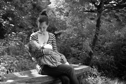 One year old girl being breastfed by her mother in Sydenham Woods, photographed by Anna Hindocha/Warm Glow Photo