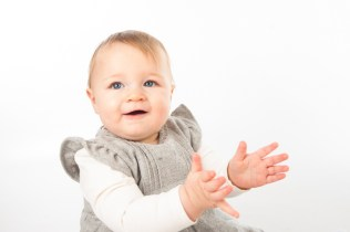 7 month old baby girl in studio. Photographed by Anna Hindocha/Warm Glow Photo