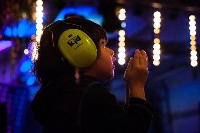 Boy wearing ear defenders at Big Fish Little Fish as part of the Mini Vault Festival, Waterloo. Photographed by Anna Hindocha/Warm Glow Photo