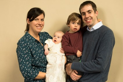 Group family portrait at catholic baptism at St. Thomas More RC Church in Dulwich. Photographed by Anna Hindocha/Warm Glow Photo