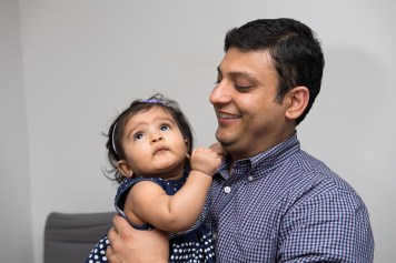 7 month old baby girl with her father.