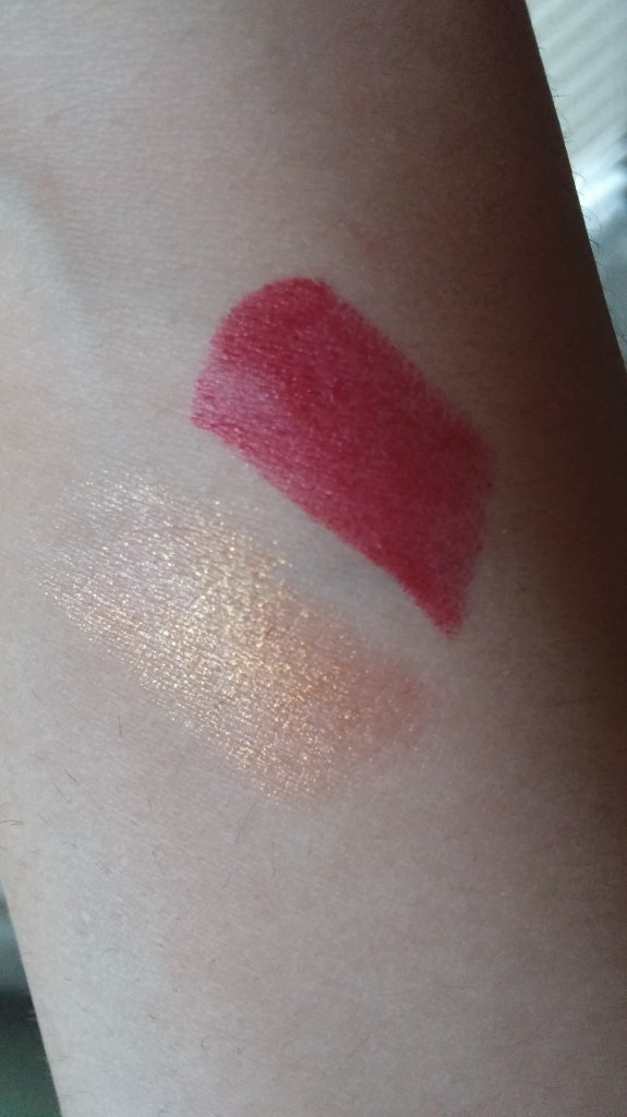 We are swatches of lipsticks. The gold one is droid (Gold 40) or Droid (I think) the red one is Red 30 I have no idea what the name for this one is but I'm sticking with NOOOOO!