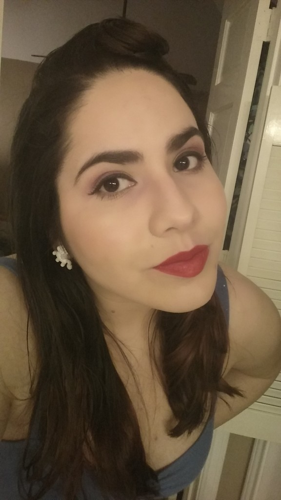 That's my face with MAC Cosmetic's Dita Von Teese red and I love it. I love it so much it hurts me physically because I never want to take it off.