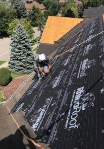 roofing contractor installing underlay