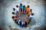 circle-of-people-arms-in-middle-of-circle