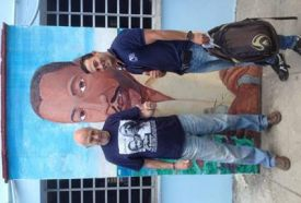 uncle-and-man-in-front-of-mural