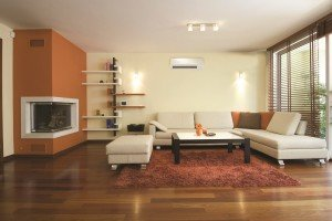 Living room with ductless heating and cooling system from Warren Heating and Cooling.