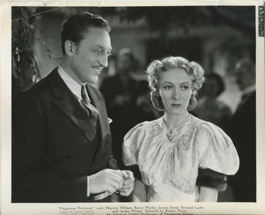 Warren William with Karen Morley in Outcast