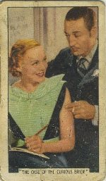 1936 Gallaher Film Episodes tobacco card features Claire Dodd with Warren William