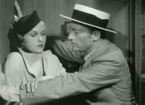 Patricia Ellis and Warren William in The Case of the Lucky Legs