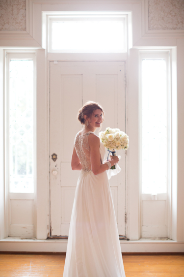 Kentucky estate wedding- Bride in main hall of Warrenwood Manor