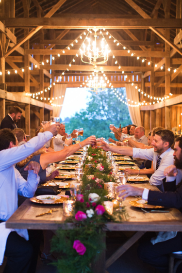 Kentucky summer wedding- rustic elegant barn wedding reception with long table and garland