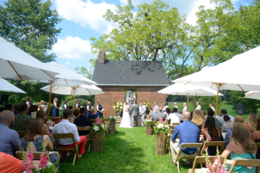 Flower-filled outdoor ceremony at Warrenwood Manor