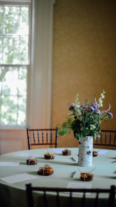 Wildflower centerpiece in birch bark vase
