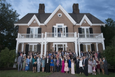 All guests pose in front of Warrenwood Manor