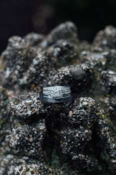 Engagement ring and wedding band on decorative home accent