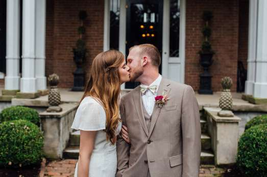 Bride & Groom in front of historic Warrenwood Manor