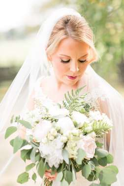 Bridal Portrait with ivory and greenery bouquet at Warrenwood Manor