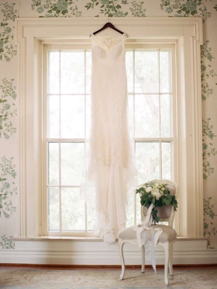 Sweetheart cut wedding dress with illustion neck and lace details in Warrenwood Bridal Suite