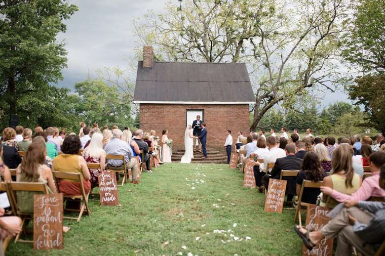 Charming Southern Wedding with wood aisle signs