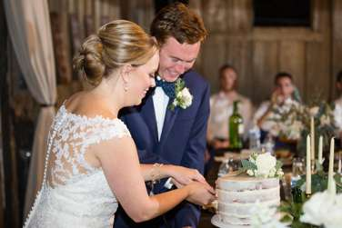Bride & Groom cut cake at classy southern barn wedding at Warrenwood Manor