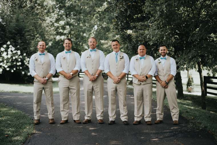 Southern rustic charm groomsmen in light khaki suits at Warrenwood Manor