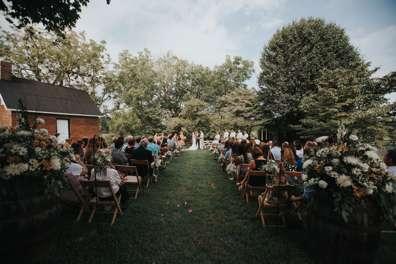 Rustic country outdoor ceremony at Warrenwood Manor, a Kentucky wedding venue.