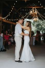 First dance at rustic country barn wedding reception