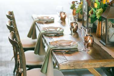 Vineyard table and chairs with copper accents
