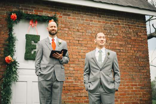Groom and Pastor waiting for bride at alter during backyard ceremony at Warrenwood Manor