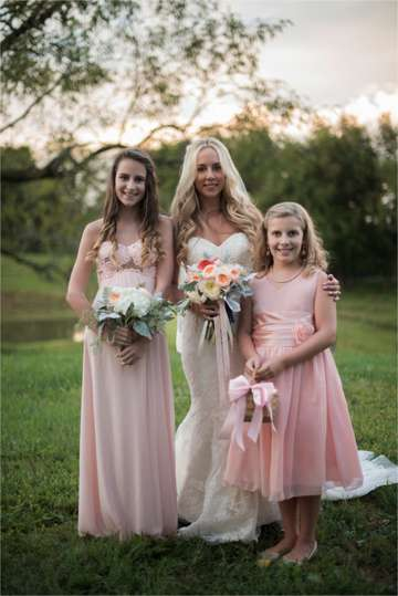 Bride and her flower girls at sunset during southern glam farm wedding
