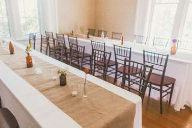 Banquet-style reception with bud vase centerpieces and burlap runner