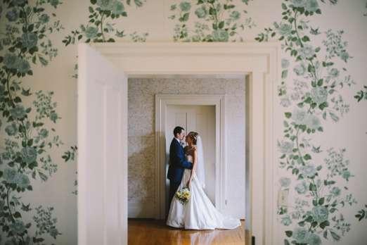 Bride & Groom against old wallpaper