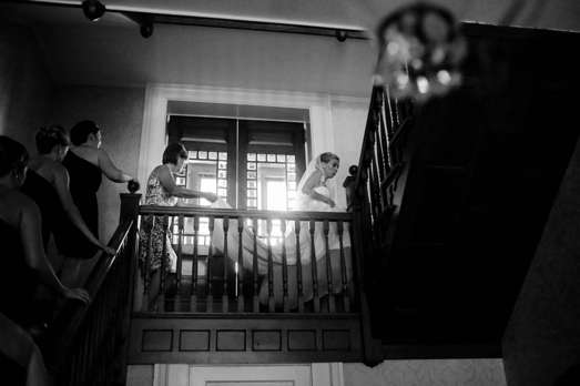 Bride on the stairs of historic home