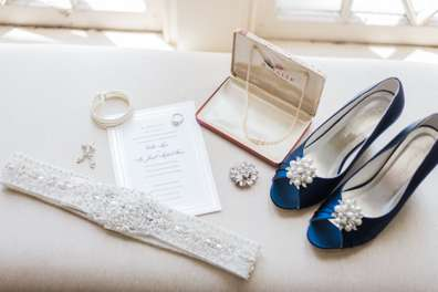 Traditional bridal accessories with wedding invitation