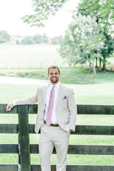 Groom in khaki, white and pink for timeless and traditional wedding